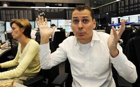 Share trader Tom Holler reacts on share price development as he looks onto his trading screens at the Frankfurt stock exchange, October 9, 2008. REUTERS/Kai Pfaffenbach