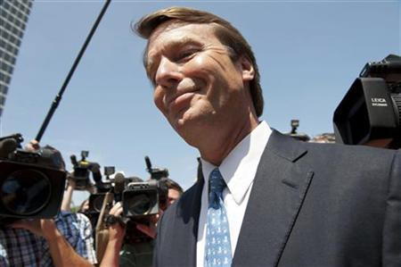 Former Democratic presidential hopeful and former Senator John Edwards departs the U.S. District Court with his daughter Cate (L-rear) after pleading not guilty to six federal charges in Winston-Salem, North Carolina, June 3, 2011. REUTERS/Davis Turner