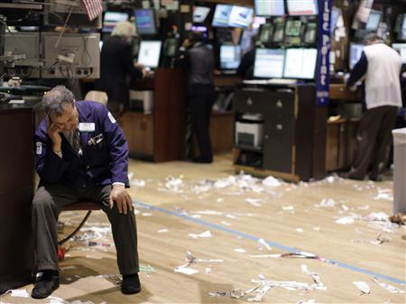 A trader reacts on the floor of the New York Stock Exchange in this file image from August 18, 2011. REUTERS/Brendan McDermid