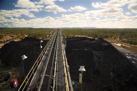 Handling and processing equipment operate above a coal stockpile at Macarthur Coal's Coppabella mine, about 760km (472 miles) northwest of Brisbane, in this undated handout photograph made available July 12, 2011. REUTERS/Macarthur Coal/Handout
