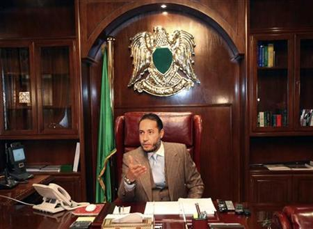 Saadi Gaddafi, a son of Libyan leader Muammar Gaddafi, speaks during a news conference at his office in Tripoli January 31, 2010. REUTERS/Ismail Zetouny