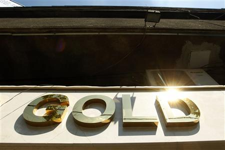 The logo of a gold jewellery shop is seen in Bucharest August 19, 2011. REUTERS/Bogdan Cristel