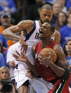 Miami Heat's Chris Bosh (below) collides with Dallas Mavericks' Tyson Chandler during Game 4 of the NBA Finals basketball series in Dallas, June 7, 2011. REUTERS/Lucy Nicholson
