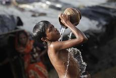 <p>A Rohingya boy bathes in a common bath place in a refugee camp in Cox's Bazar, in this file picture taken August 19, 2011. REUTERS/Andrew Biraj</p>