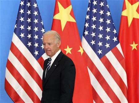 U.S. Vice-President Joe Biden arrives with his Chinese counterpart Xi Jinping (not pictured) at a China-US Business Dialogue in the Beijing Hotel in Beijing August 19, 2011. REUTERS/How Hwee Young/Pool