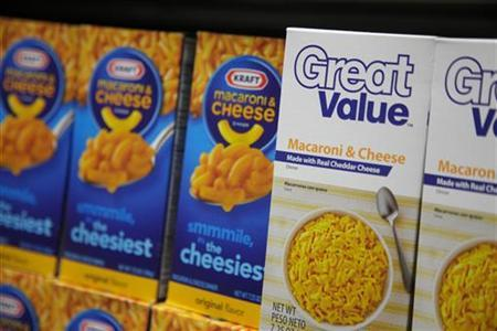 Wal-mart private-label store brand Great Value's Macaroni and Cheese products are pictured next to Kraft's inside a new Walmart Express store in Chicago July 26, 2011. REUTERS/John Gress