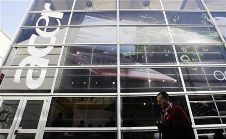 A man walks past an 'Acer' office during the Mobile World Congress in Barcelona February 18, 2010. REUTERS/Albert Gea