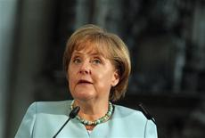 <p>German Chancellor Angela Merkel delivers a speech after receiving the Emperor Otto Prize in the Magdeburg Cathedral in Magdeburg August 24, 2011. REUTERS/Thomas Peter</p>