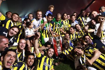Fenerbahce players and team members celebrate with the Turkish Super League trophy during a ceremony at the Sukru Saracoglu stadium in Istanbul May 23, 2011. Fenerbahce won its 18th Turkish league title on Sunday. REUTERS/Murad Sezer