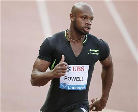 Asafa Powell from Jamaica runs to win the men's 100 meters during the Lausanne Diamond League (Athletissima) athletics meeting at the Stade de la Pontaise in Lausanne June 30, 2011. REUTERS/Ruben Sprich