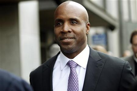 Former San Francisco Giants baseball player Barry Bonds leaves the Phillip Burton Federal Building after he was found guilty on one count of obstruction of justice and mistrial on three counts of perjury in San Francisco, California April 13, 2011. REUTERS/Stephen Lam