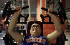 <p>A man lifts weight as part of his training during a six-week programme in an exercise room at the Bodyworks weight loss campus in Beijing August 26, 2011. REUTERS/Soo Hoo Zheyang</p>