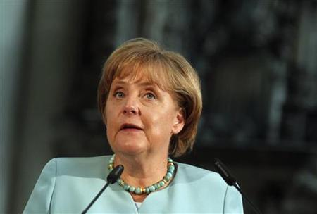 German Chancellor Angela Merkel delivers a speech after receiving the Emperor Otto Prize in the Magdeburg Cathedral in Magdeburg August 24, 2011. REUTERS/Thomas Peter