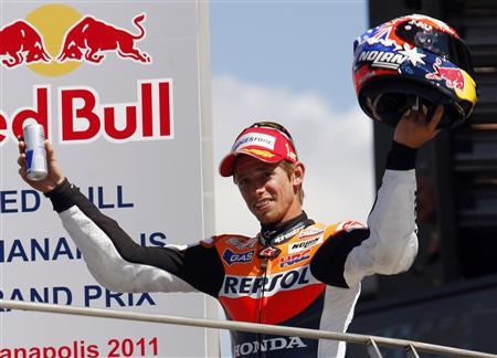 Honda MotoGP rider Casey Stoner of Australia smiles on the podium after winning the Indianapolis Grand Prix in Indianapolis August 28, 2011. REUTERS/Brent Smith