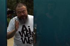 <p>Dissident Chinese artist Ai Weiwei closes the door to his studio after speaking to the media in Beijing June 23, 2011. REUTERS/David Gray</p>