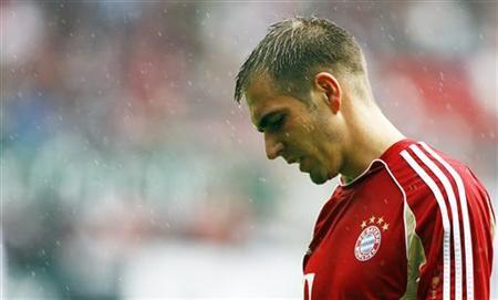 Bayern Munich's Philipp Lahm reacts before their German Bundesliga soccer match against 1.FC Kaiserslautern in Kaiserslautern August 27, 2011. REUTERS/Thomas Bohlen