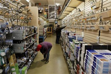 Shoppers look for items in the home improvement department of a Home Depot store in New York, April 13, 2011. REUTERS/Lucas Jackson