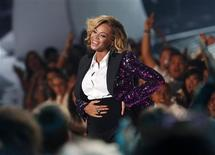 "<p>Beyonce, who announced her pregnancy earlier in the day, rubs her stomach after performing ""Love On Top"" at the 2011 MTV Video Music Awards in Los Angeles, August 28, 2011. REUTERS/Mario Anzuoni</p>"