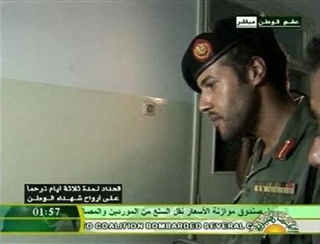 Still image from video footage by Libyan state television shows what it says is Muammar Gaddafi's son Khamis visiting wounded Libyans in a hospital. Libyan TV said the footage was recorded on August 9, 2011, and if genuine, will be the first visual proof by Gaddafi's government that Khamis is still alive. REUTERS/Libya TV via Reuters TV