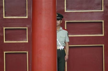 A paramilitary policeman stands next to a gate at the Forbidden City, in central Beijing, August 25, 2011. REUTERS/Jason Lee