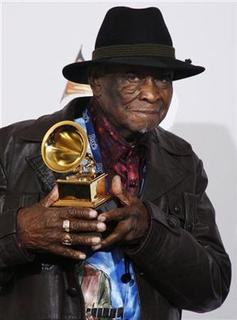 David ''Honeyboy'' Edwards poses with the Best Traditional Blues Album Grammy Award he won for ''Last of the Great Mississippi Delta Bluesman: Live In Dallas'' along with other musicians not present, at the 50th Annual Grammy Awards in Los Angeles February 10, 2008. REUTERS/Lucy Nicholson