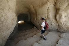 <p>A tourist visits Hirbet Madras archaeological site, featuring ancient rebel hideouts, at the foothills of Jerusalem around the ancient city of Beit Guvrin August 23, 2011. REUTERS/Baz Ratner</p>