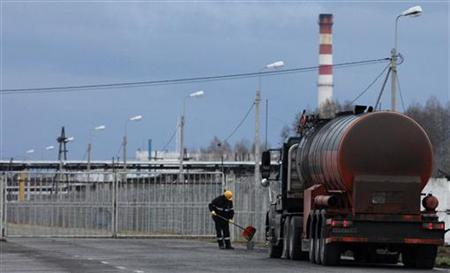 An employee works near a gasoline tank truck outside the Rosneft Achinsk oil refinery plant, one of the biggest Siberian fuel suppliers, near the town of Achinsk, some 117 miles west of Krasnoyarsk, April 28, 2011. REUTERS/Ilya Naymushin