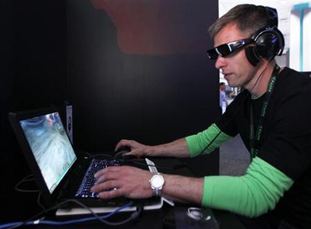 An attendee plays Everquest in 3-D wearing Sony's 3-D glasses and PC gaming audio headset at the Sony Online Entertainment booth during the Electronic Entertainment Expo or E3 in Los Angeles June 7, 2011. REUTERS/Danny Moloshok