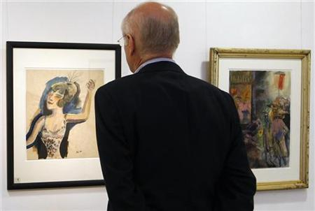 Gallery owner Herbert Remmert looks at recently discovered paintings of German artist Otto Dix during an exhibition in his gallery in Duesseldorf, August 31, 2011. REUTERS/Ina Fassbender