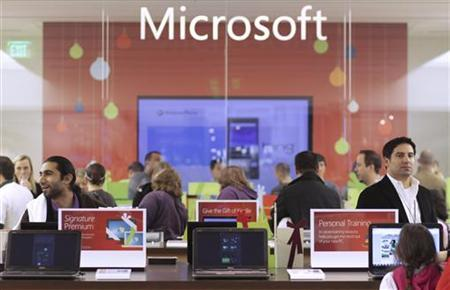 Customers shop at the new Microsoft Store in Bellevue, Washington, November 18, 2010. REUTERS/Marcus Donner