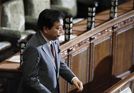 Japan's next prime minister Yoshihiko Noda walks to cast a ballot at the lower house of parliament in Tokyo August 30, 2011. REUTERS/Toru Hanai