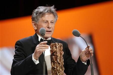 Director Roman Polanski speaks after winning the Best Adaptation award for his film ''The Ghost Writer'' during the 36th Cesar Awards ceremony in Paris February 25, 2011. REUTERS/Benoit Tessier