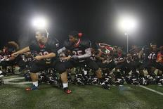 "<p>Moments after beating rival Lee High School 30-7, the Trinity Trojans football team drop their helmets and perform their ""haka"" war dance one more time for the crowd, August 26, 2011. In front are players Bryan Munoz Paul Tuipulotu. REUTERS/Charlie L. Harper III</p>"
