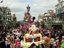 <p>Walt Disney's Mickey Mouse along with various characters waves to the crowd on a giant birthday cake, at Euro Disney's theme park on the edge of Paris, in a file photo. REUTERS/File</p>