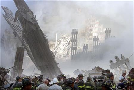 Firefighters at the destroyed World Trade Center, September 11, 2001. REUTERS/Shannon Stapleton