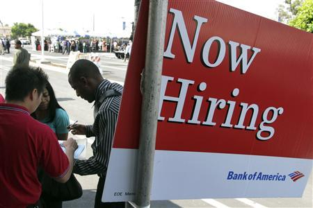Martell Gerald (R) applies for a job at the Bank of America booth at the Congressional Black Caucus For The People Jobs Initiative job fair in Los Angeles, California in this August 31, 2011 file phto. REUTERS/Jonathan Alcorn/Files
