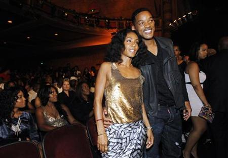 Actress Jada Pinkett Smith and her husband actor Will Smith pose at the 2011 BET Awards in Los Angeles June 26, 2011. REUTERS/Mario Anzuoni
