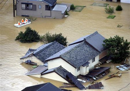 An aerial view shows houses submerged in flood water caused by the strong tropical storm Talas in Kiho town, Mie prefecture, in western Japan September 4, 2011. REUTERS/Kyodo