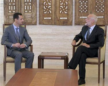 Syria's President Bashar al-Assad (L) meets Jakob Kellenberger, president of the International Committee of the Red Cross (ICRC), in Damascus September 5, 2011, in this handout photograph released by Syria's national news agency SANA. REUTERS/Sana/Handout