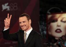 "<p>Actor Michael Fassbender gestures as he arrives on the red carpet for the film ""A Dangerous Method"" directed by director David Cronenberg at the 68th Venice Film Festival September 2, 2011. REUTERS/Alessandro Bianchi</p>"