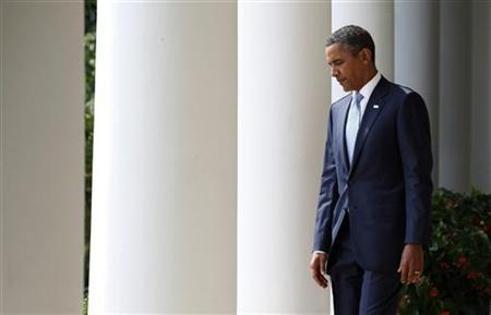 President Barack Obama walks out before he announces that labor economist Alan Krueger (not shown) as his choice to be the Chairman of the White House Council of Economic Advisers in the Rose Garden of the White House in Washington, August 29, 2011. REUTERS/Larry Downing