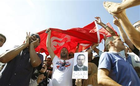 Tunisian police officers and security personnel chant slogans during a demonstration in Tunis September 6, 2011. REUTERS/Zoubeir Souissi