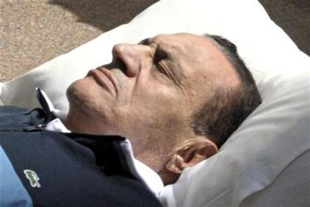 Former Egyptian president Hosni Mubarak lies on his bed while being taken to the courtroom at the police academy in Cairo September 7, 2011. REUTERS/Stringer
