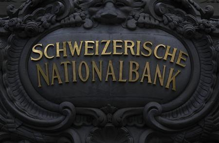 The Swiss National Bank (SNB) logo is pictured on the SNB building in Bern in this July 29, 2011 file photo. REUTERS/Pascal Lauener/Files