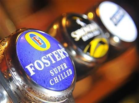 A Foster's logo is seen on a beer pump at an Australian themed bar in west London August 18, 2011. REUTERS/Toby Melville