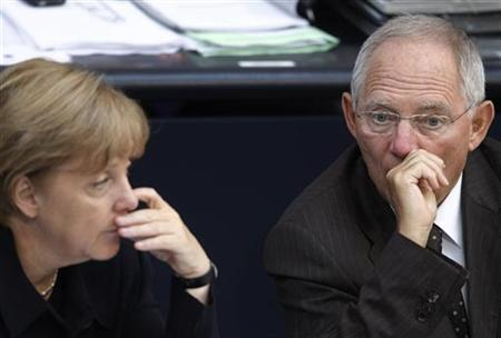 German Chancellor Angela Merkel (L) and Finance Minister Wolfgang Schaeuble listen to a budget debate in the Bundestag, the German lower house of parliament in Berlin, September 7, 2011. REUTERS/Thomas Peter