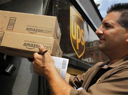 UPS driver T.J. Dellasala delivers two packages from Amazon.com in Boston, Massachusetts in this July 26, 2011 file photo. REUTERS/Brian Snyder