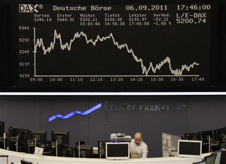 A trader works at his desk under the DAX index board at Frankfurt's stock exchange September 6, 2011. REUTERS/Remote/Kirill Iordansky