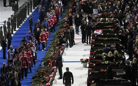 People gather at Arena-2000, home venue of ice hockey team Lokomotiv Yaroslavl, as they pay their last respects to the victims of Wednesday's plane crash, in Yaroslavl September 10, 2011. REUTERS/Denis Sinyakov