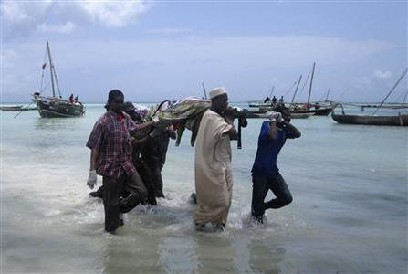 Rescuers carry the bodies of victims from a ferry tragedy near Zanzibar Island at Nungwi Beach September 10, 2011. REUTERS/Beatrice Spadacini
